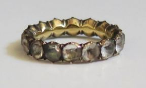 A Georgian Paste Full Eternity Ring in an unmarked gold setting, size K.5, 3g