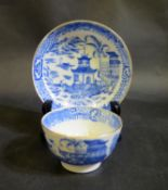 A Blue and White Porcelain Tea Bowl with matching saucer