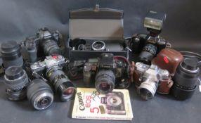 A Canon EOS3 35mm SLR Camera, Canon T90, Minolta XD7, Kodak Reflex III, Sigma 10-20mm 1:4-5.6 DC HSM