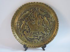 A Persian Embossed Brass Charger, 34.5cm diam.