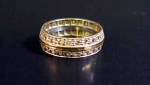 A 9ct White and Yellow Gold Diamond Twin Row Eternity Ring, size O.5, 5.5g