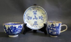 A Blue and White Porcelain Willow Pattern Tea Bowl, coffee can and saucer