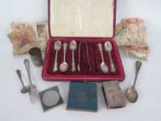 A Russian Silver and Niello Engraved Shot (28g), sterling silver teaspoons and tongs (140g), vest