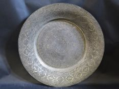 An Islamic Silvered Copper Charger, 53cm diam.