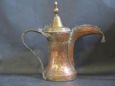 An Early and Large Middle Eastern Islamic Copper and Brass Coffee or Ritual Water Pot with pricked