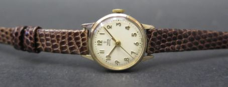 A Ladies TUDOR Royal 9ct Gold Cased Manual Wind Wristwatch with 17 jewel movement, case no 7303.