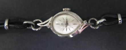A Ladies TISSOT 14K White Gold and Diamond Wristwatch, with 17 jewel manual wind movement no.