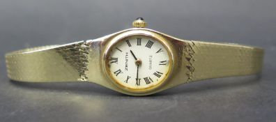 A Ladies Zenith 9ct Gold Quartz Wristwatch with box and sales card, 22.1g including watch