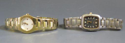 A Ladies TISSOT Gold Plated Wristwatch, running and CITIZEN Titanium wristwatch
