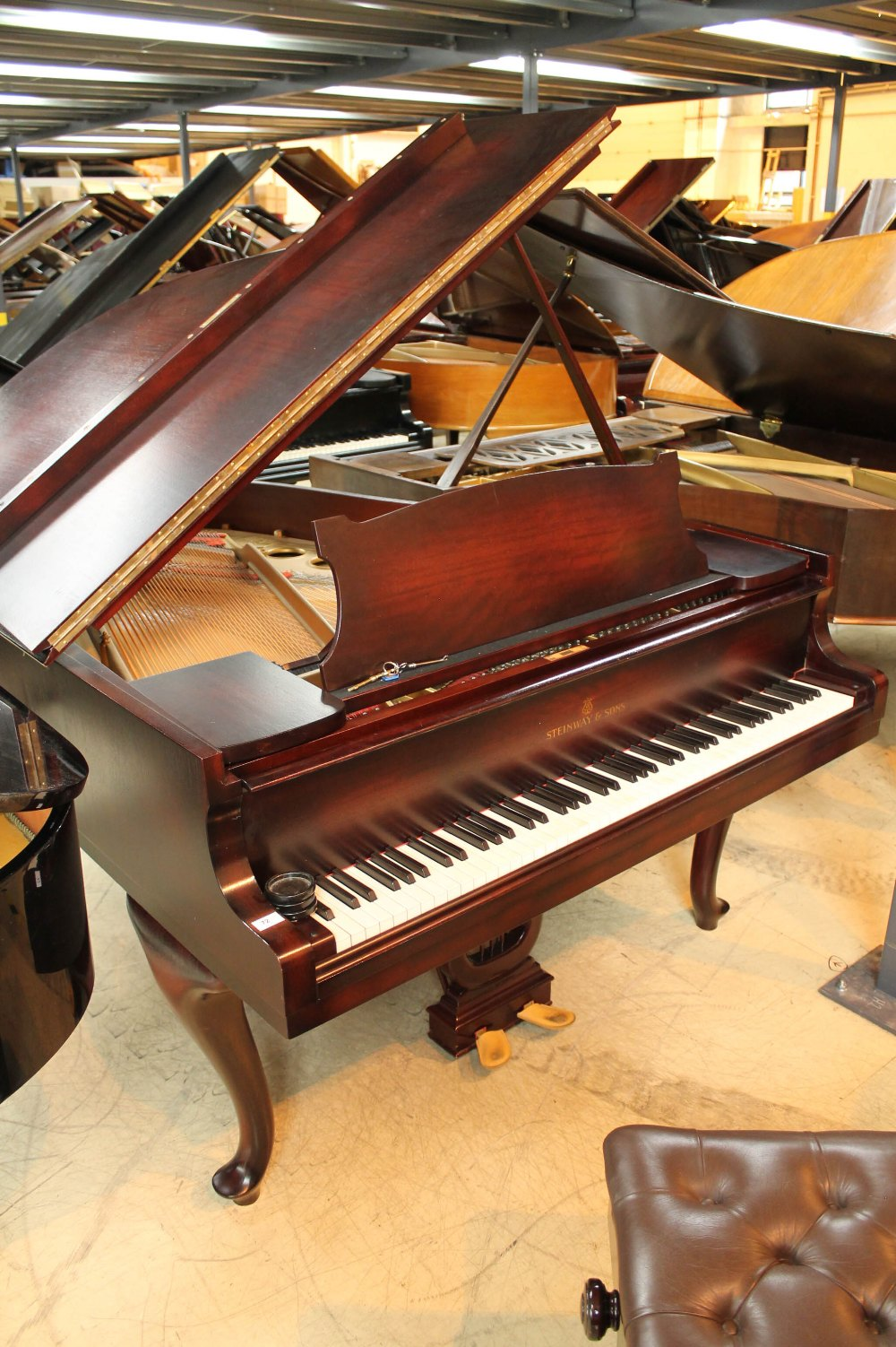 Steinway (c1940) A 5ft 10in Model O grand piano in a mahogany case on cabriole legs;
