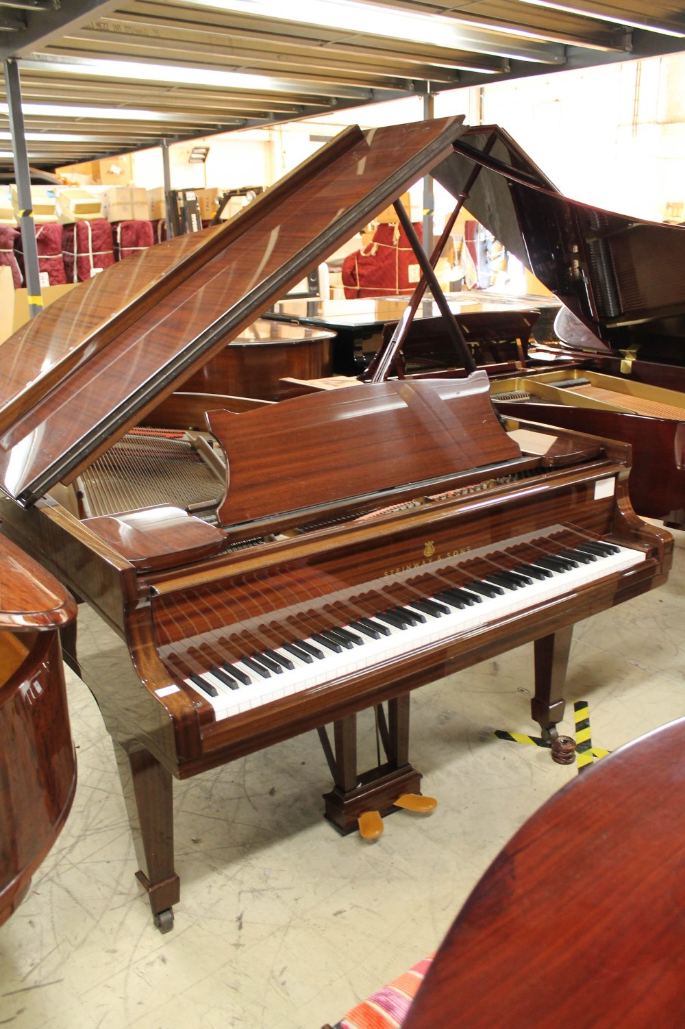 Steinway (c1979) A 5ft 10in Model O grand piano in a bright mahogany case on square tapered legs;