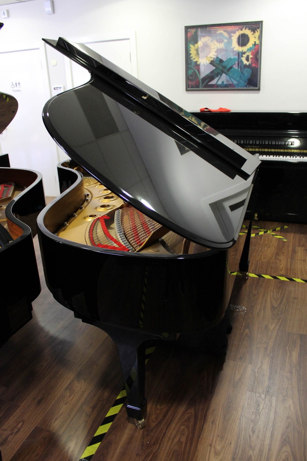 Steinway (c2015) A 6ft 11in Model B grand piano in a bright ebonised case on square tapered legs; - Image 7 of 8