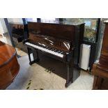 Welmar (c1996) A 126cm upright piano in a traditional bright mahogany case.