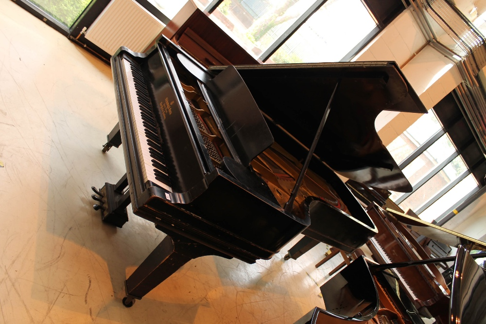 Steinway (c1888) A 9ft concert grand piano in an ebonised case on turned legs.