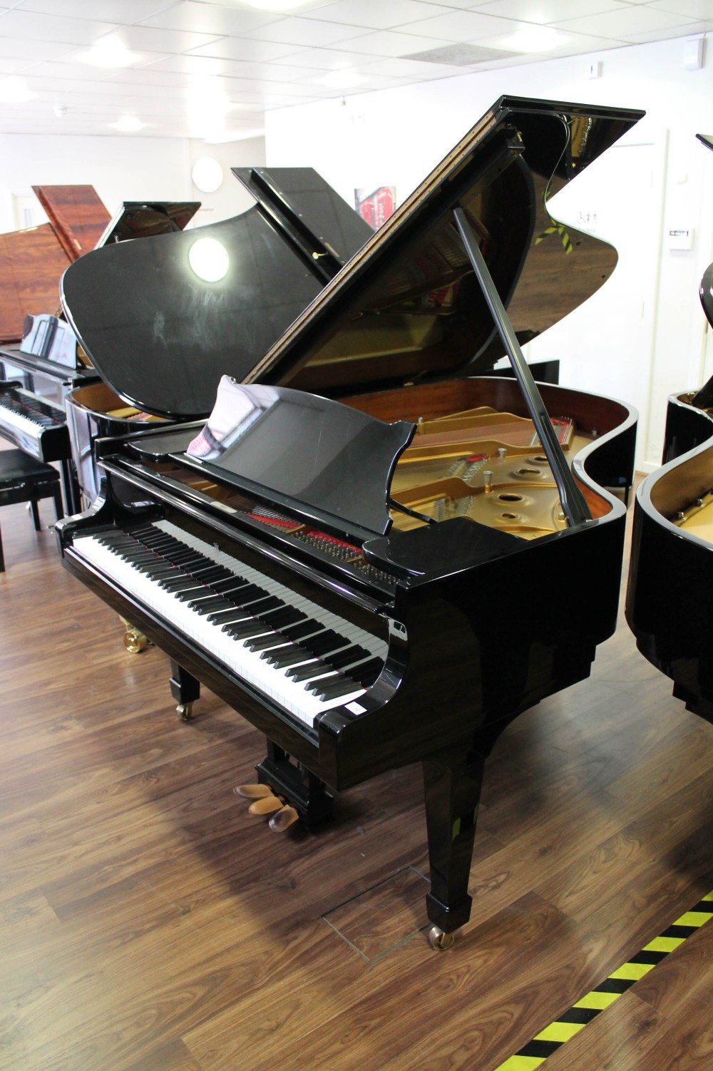 Steinway (c1986) A 6ft 2in Model A grand piano in a bright ebonised case on square tapered legs.