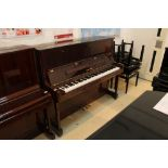 Yamaha (c1991) A Model U1N 120cm upright piano in a bright mahogany case; together with a stool.