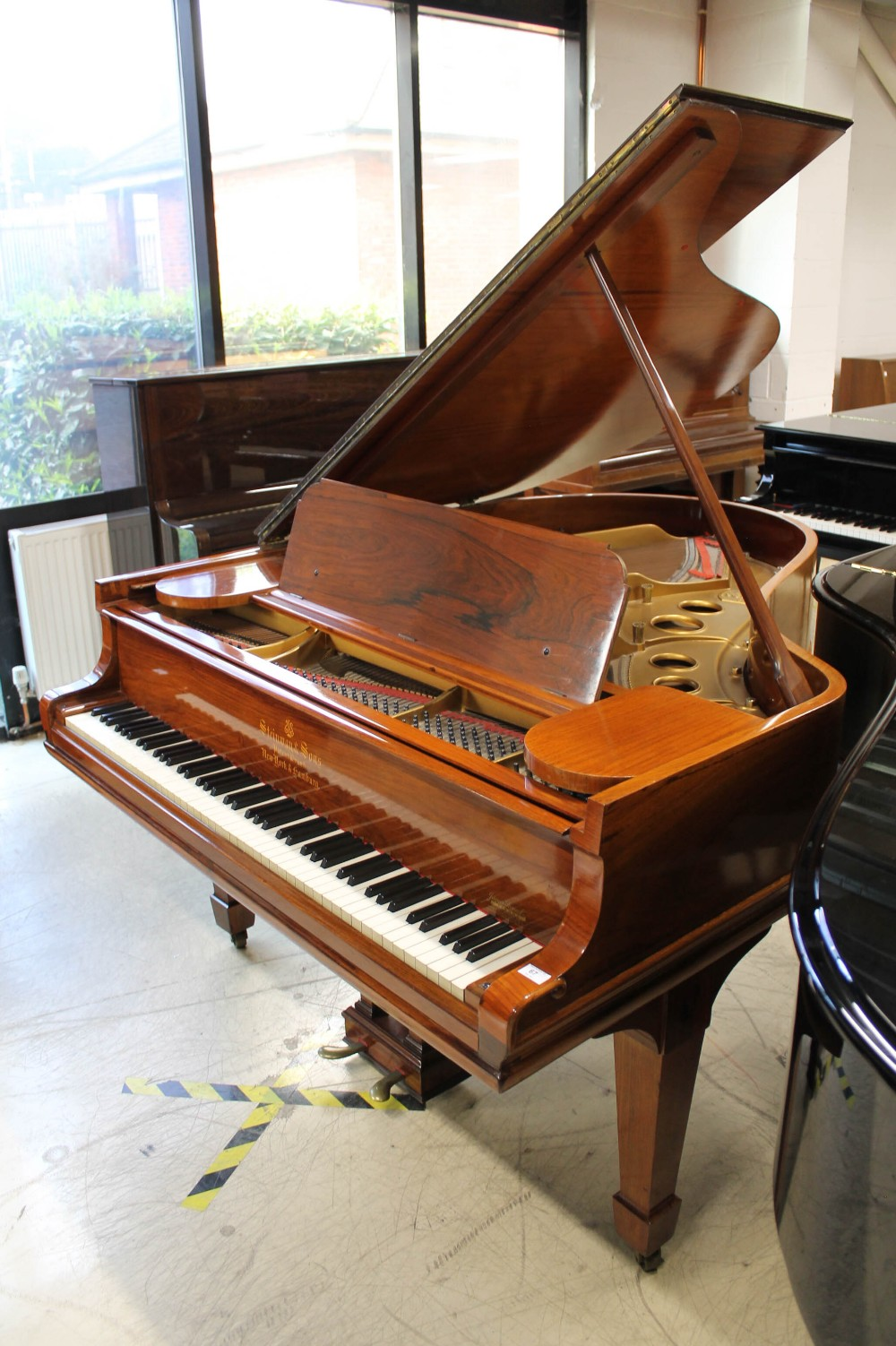Steinway (c1908) A 5ft 10in Model O grand piano in a rosewood case on square tapered legs.