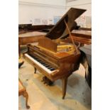 Blüthner (c1932) A 4ft 11in Model 11 grand piano in a flame mahogany case on square tapered legs;