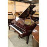 Boston (c2009) A 5ft 10in Model GP178 grand piano in a bright mahogany case on square tapered legs;