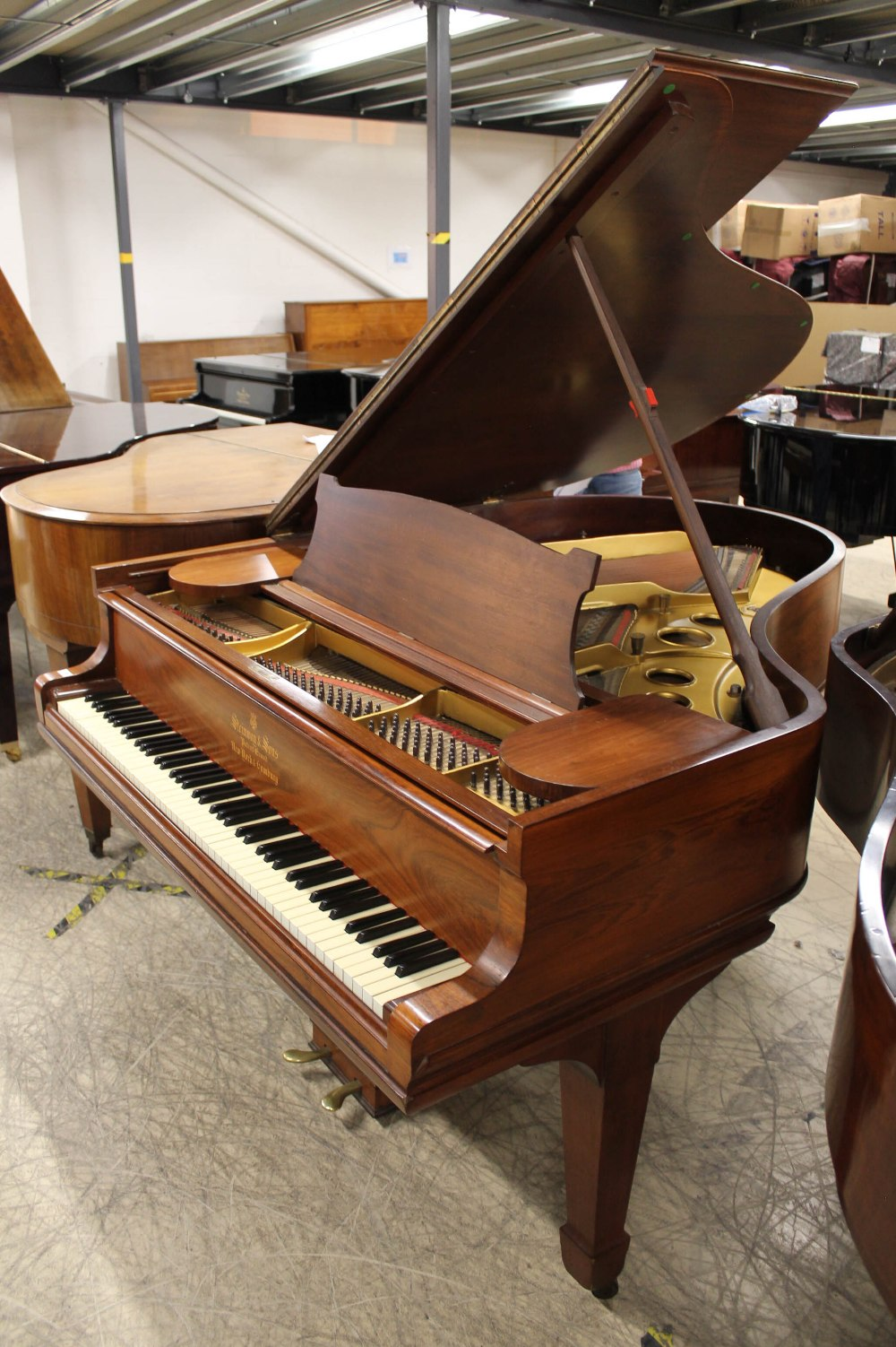 Steinway (c1904) A 5ft 10in Model O grand piano in a rosewood case on square tapered legs;