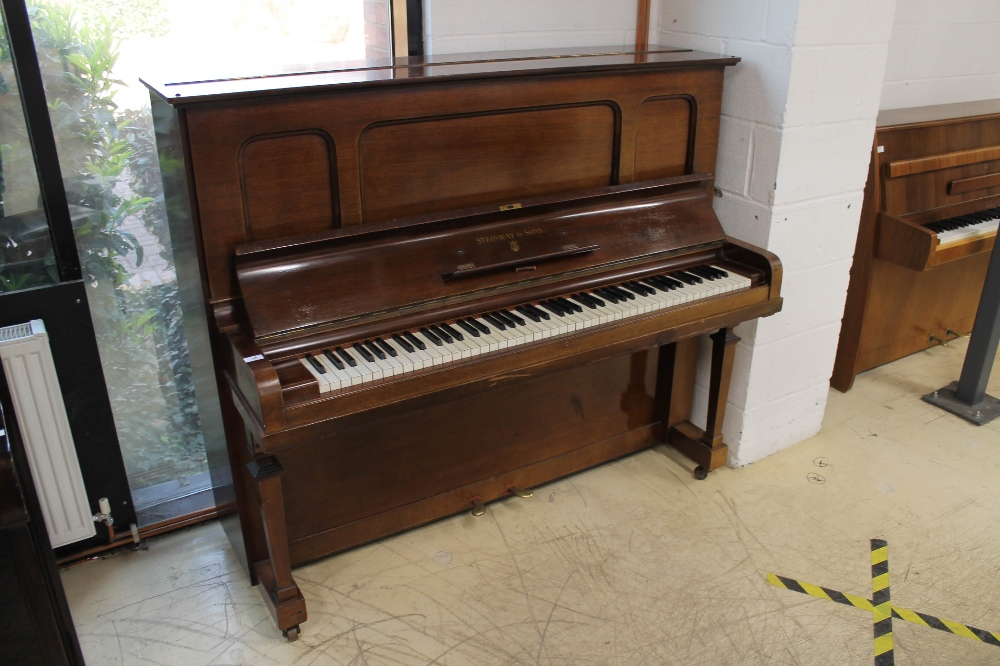 Steinway (c1929) A Model K upright piano in a mahogany case; together with a stool.