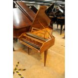 Sperrhake (c1960's) A 4ft 9in harpsichord in a walnut case on three slender square tapered legs.
