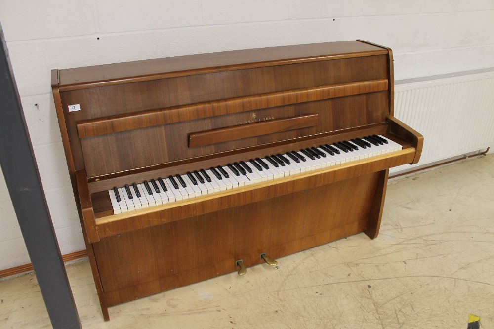 Steinway (c1964) A Model Z upright piano in a modern style walnut case; together with a stool.