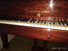 Steinway (c1924) A 5ft 10in Model O grand piano in a fiddleback mahogany case with square tapered