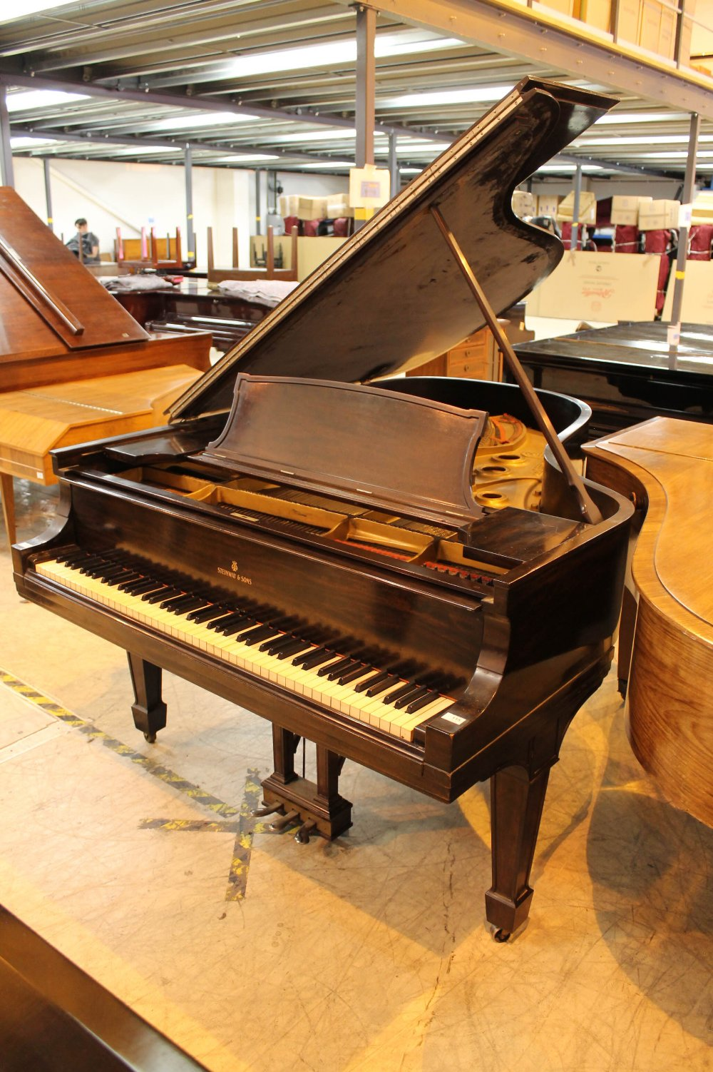 Steinway (c1921) A 191cm New York Model A grand piano in a mahogany case on square tapered legs.