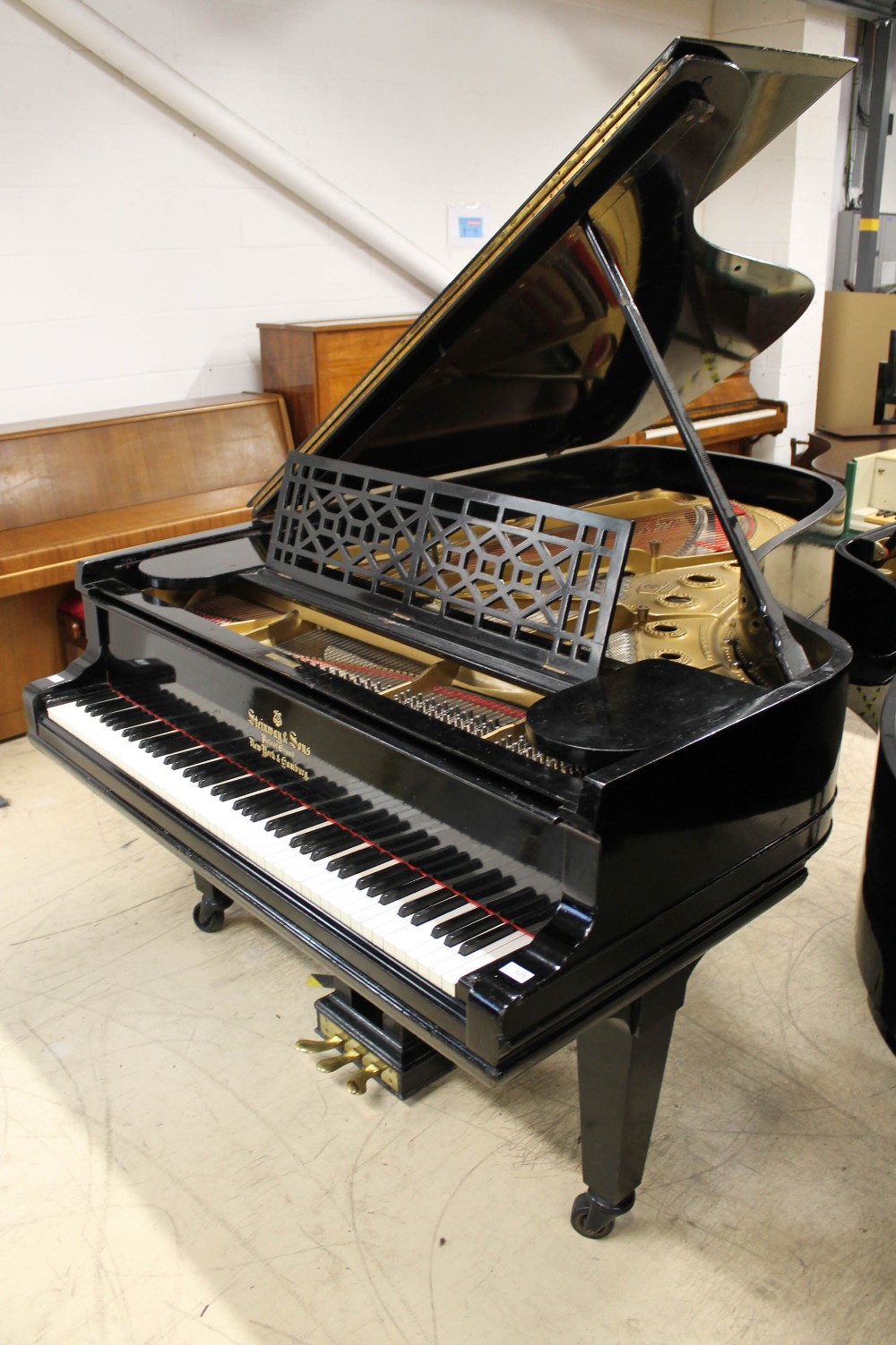 Steinway (c1898) A 6ft 2in 88-note Model A grand piano in an ebonised case on square tapered legs.