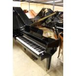 Kawai (c1996) A 5ft 10in grand piano in a bright ebonised case on square tapered legs.