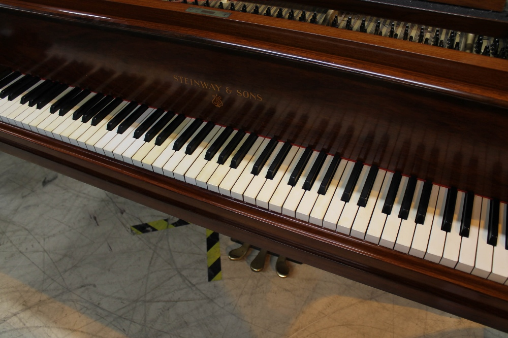 Steinway (c1928) A 7ft 5in grand piano in a French polished rosewood case on square tapered legs. - Image 2 of 8