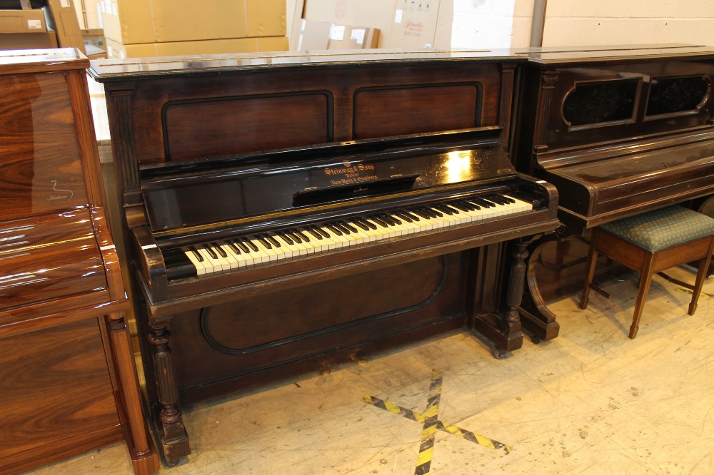 Steinway (c1902) A Style 1 upright piano in a rosewood case.