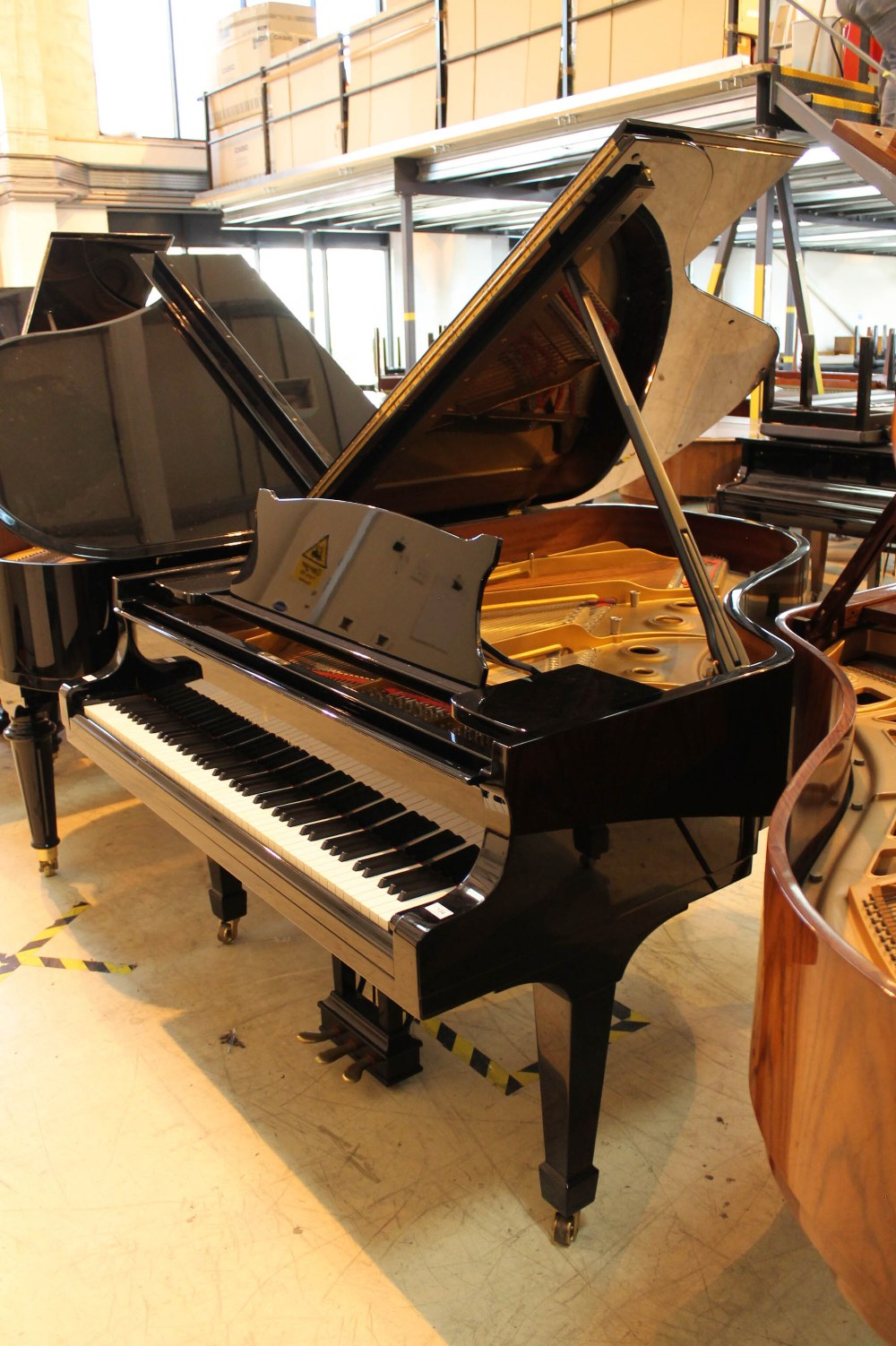 Steinway (c1983) A 6ft 2in Model A grand piano in a bright ebonised case on square tapered legs.
