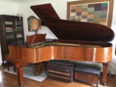 Steinway (c1928) A 7ft 5in grand piano in a French polished rosewood case on square tapered legs.