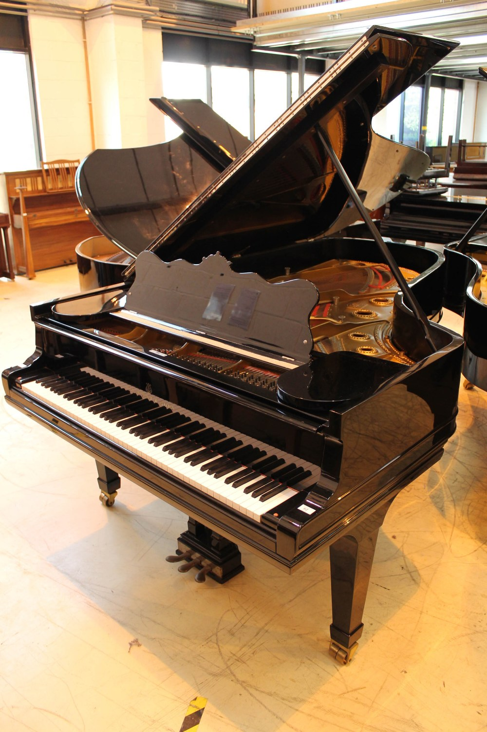 Steinway (c1902) A 7ft 5in Model C grand piano in a bright ebonised case on square tapered legs;