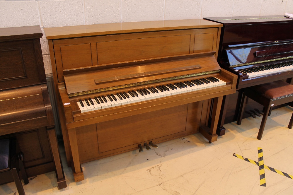 """Steinway (c1969) A """"New York Professional"""" upright piano in a walnut sable case;"""