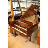 Morley Double Manual Harpsichord A double manual harpsichord in a walnut crossbanded and flame