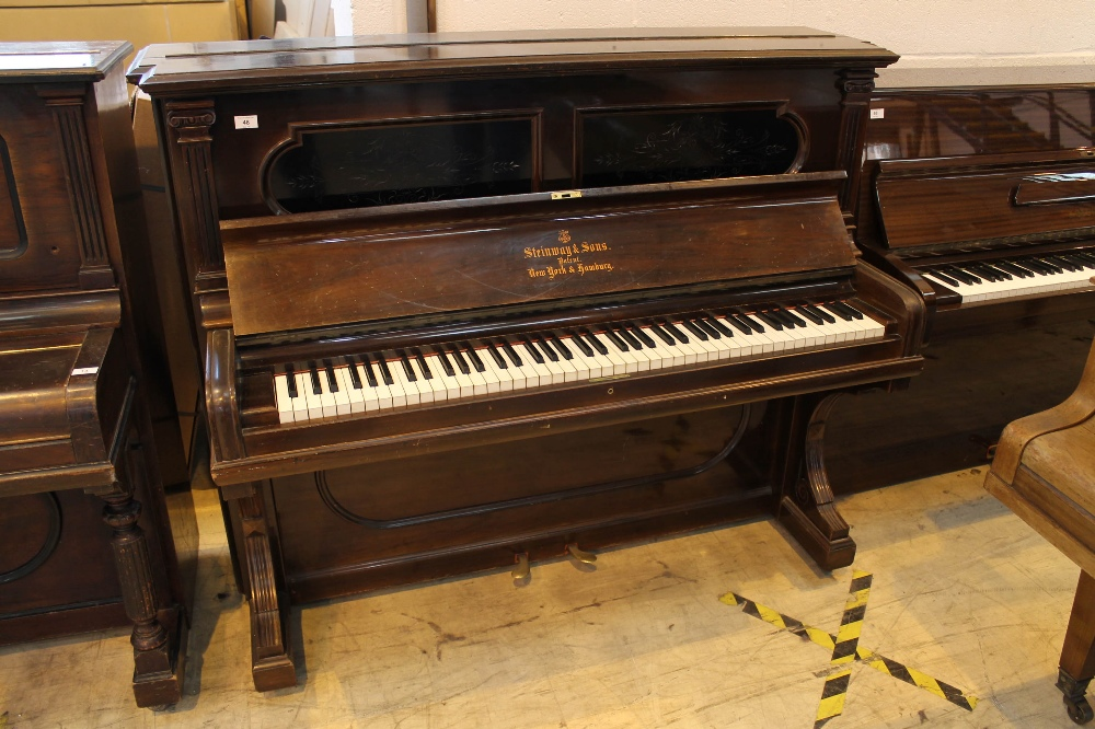 Steinway (c1892) An upright piano in a rosewood case; together with a stool.
