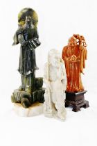 A Chinese carved soapstone figure of Shoulao, the Chinese god of longevity, on carved plinth,