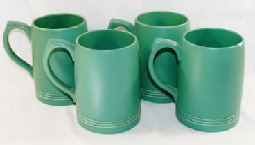 A set of four green glazed Wedgwood tankards by Keith Murray, 2.