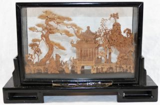 A 20th century Chinese carved cork landscape diorama, depicting trees, a pagoda and cranes,