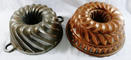 A large Victorian copper jelly mould, with hollow centre and layered spiral and fluted design,
