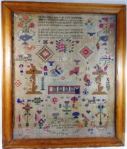 A large 19th century sampler by Anne Evans, aged 15 years, dated 1856,