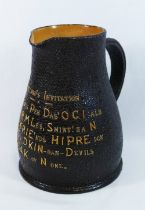 A Royal Doulton tavern jug in the form of a leather jack,