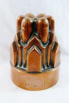 A Victorian castellated copper jelly mould, stamped with maker's mark 'R&B' to the rim, 14.