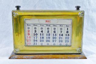 An early 20th century oak desk calendar,