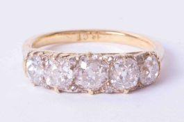 An 18ct Edwardian five stone diamond ring, total weight approx 3 carats, size R.