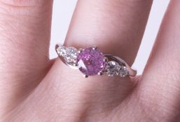 A platinum diamond and pink sapphire ring, size N.