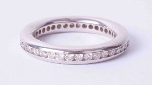 An 18ct white gold diamond full band eternity ring, size N.